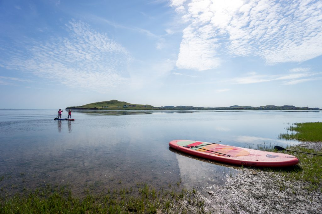 SUP with Cindy Hook paddleboarding in the Havre-aux-Maisons bay