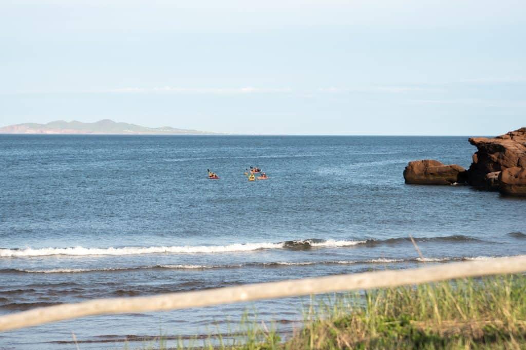 Kayaks around Gros Cap in Îles de la Madeleine