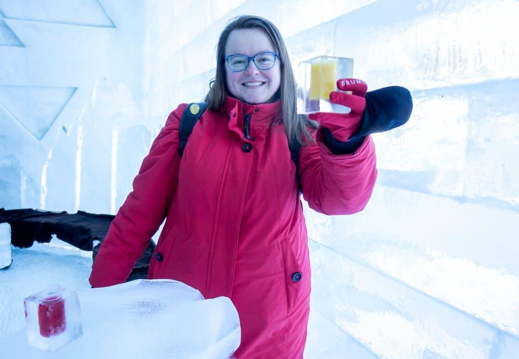 Jennifer having a frozen cocktail inside the Ice Hotel in Quebec